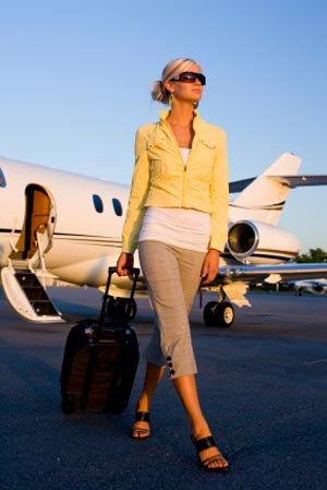 Purveyors of Time - woman leaving private jet